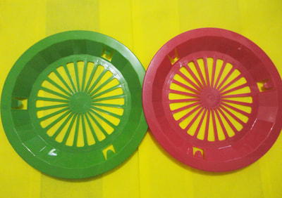 red and green plastic bilao holder with white paper plate